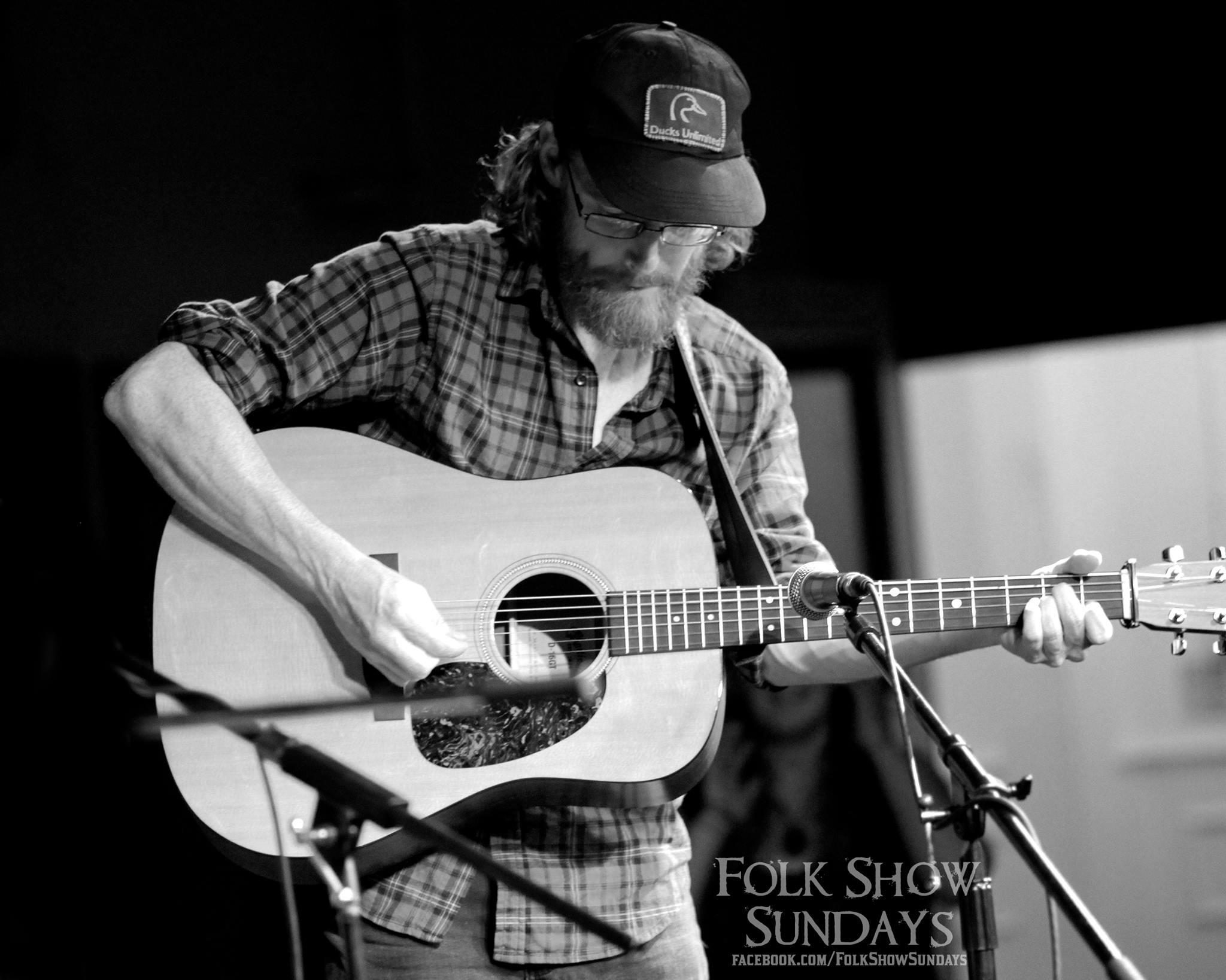 Photo of Dan Belgue performing